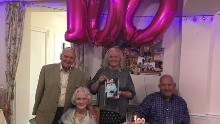 Laura Dyer celebrates her 100th birthday with her daughter Melinda Martin, Melinda's husband Jack an