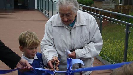 Margaret and Flynn cut the ribbon. Picture: Callum Lawton