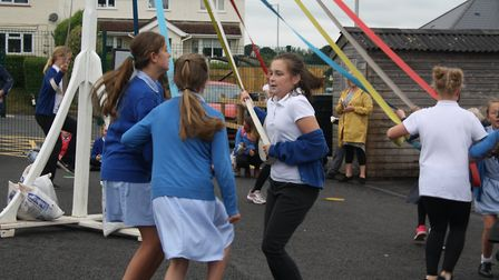 Pupils take part in the may pole dance. Picture: Callum Lawton