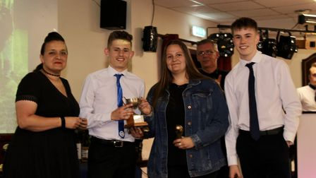 The Ottery St Mary Football Club Most Improved Player award winners with Devon ladies manager and al