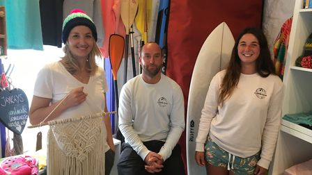 Jurassic Paddle Sport owner Guy Russell has opened a surf shop, pictured with Jenny Kim and Maddie T
