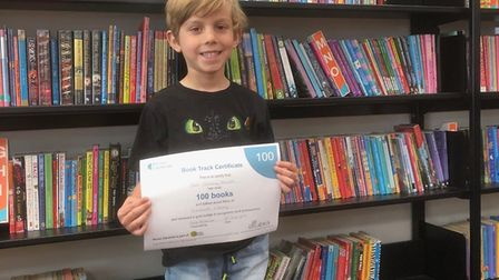 Sam, six, is the latest youngster to complete the book track challenge. Picture: Sidmouth Library