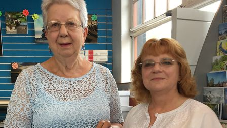 Caroline Stanley and Christine Teague from Sidford WI with the group's book Herstory. Picture: Sidfo