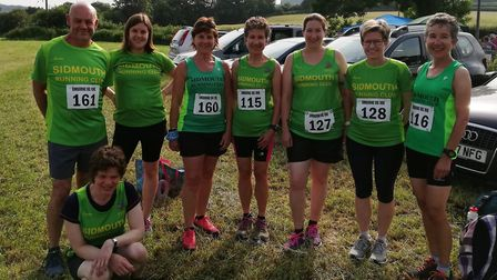 The eight Sidmouth Running Club 'Mighty Green' members before taking on the Umbourne Ug. Picture SI