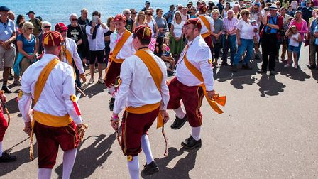 Morris dancing on the seafront. Picture: Sidmouth Folk Festival