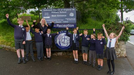 Sidmouth Primary School Head Teacher Claire Fegan with pupils celebrating their great Ofsted report.