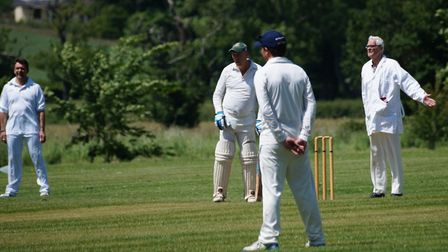 Tipton St John player David Higgins has the umpires coat as he prepares to resume play. Picture PHIL