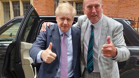 Stuart Hughes met Boris Johnson during a trip to London and posed with the Conservative party candid