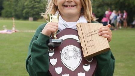 Elsie Wiltshire (age 9) one of the Sidmouth juniors showing her haul of trophies. She won her age ca