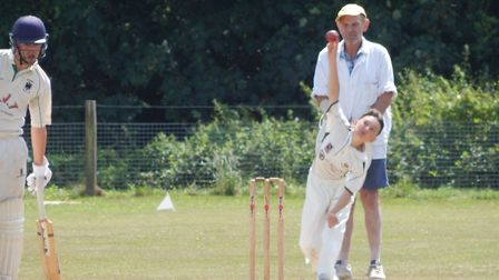 Ben Fisher bowling for Sidmouth III in the meeting with Bradninch II at Newton Poppelford. Picture S