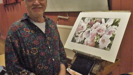 Trevor Waugh with his painting of roses. Picture: Otter Vale Art Society