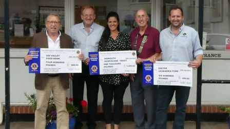 The recipients of the Corporate Duck Race prize money. Picture: Sidmouth Lions.