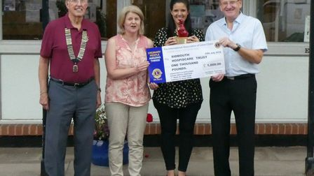 Chris Rignall, Lions Club president, with Gill Ryall of Hospiscare, and Lola Luscombe and David Lee