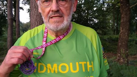 Sidmouth Running Club's David Skinner with his medal from the Prusty Plod meeting at Stoke gabriel.