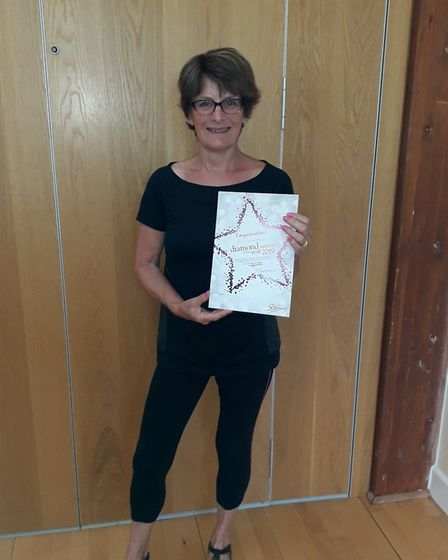 Rita Smith with her diamond award from Slimming World. Picture: Sidmouth Slimming World