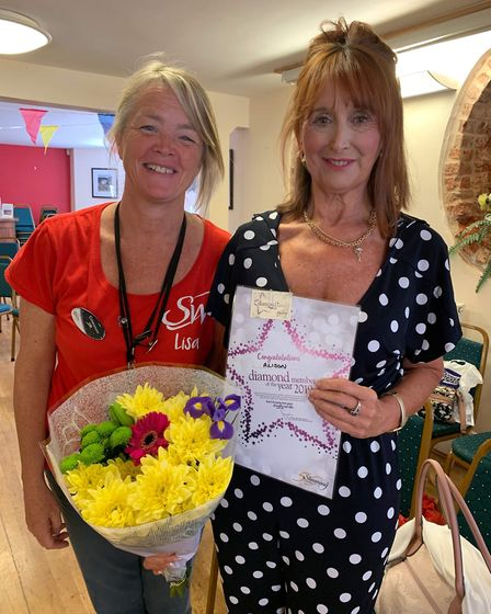 Alison Atkin with consultant Lisa Craig with her diamond award. Picture: Sidmouth Slimming World
