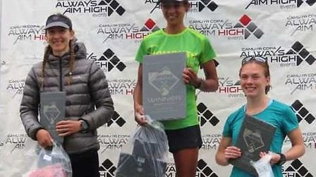 Kirsteen Welch on the podium after the Always Aim Higher, Snowdon Marathon Trail race. Picture SIDMO