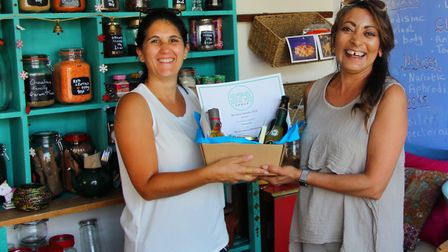 Tina Chauhan-Challis, the Samosa Lady of Ottery, with her award for Best Sole Trade/Micro business