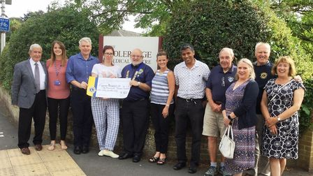 Lions Club President Brian Richards presents a cheque for £1,760 to Briony Gotch, from Cancer Resea