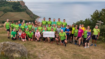 Sidmouth Running Club meet on the Coast Path to present their cheque for £250. Picture: Michael Gins