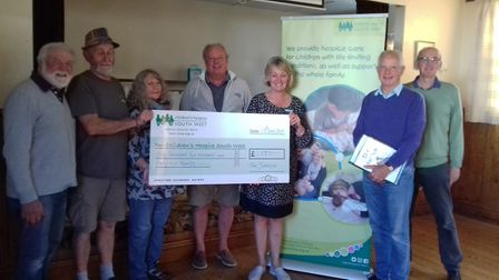The Jurassix presented £1,255 cheque to Children's Hospice South West. Picture: CHSW