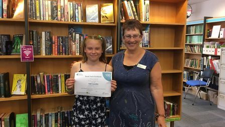 Alice, 10, with Sidmouth Library's Carol Pentecost after completing her book track award. Picture: C