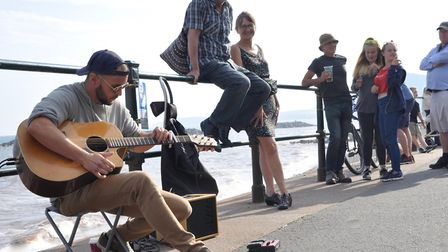 Jamie Hocking performing on the seafront. Picture: Paul Strange