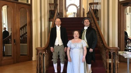 A costumed dancer with leader Stuart Marsden and his assistant Caroline. Picture: Maria McCarthy