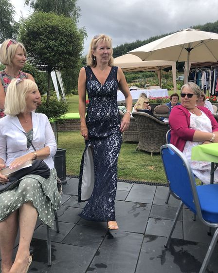 Models showed off eight outfits along a garden catwalk. Picture: Sarah Gibbs