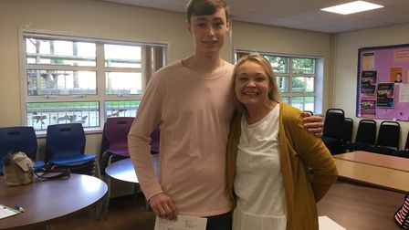 Owen Waters with his mum Karen celebrated his A level results at The King's School in Ottery. Pictur