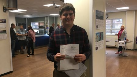 Tom Dodds with his A level results at The King's School in Ottery. Picture: Clarissa Place