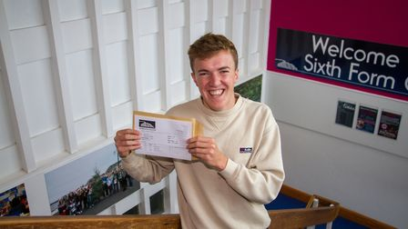 Toby Garrick with his Sidmouth College A Level results. Ref shs 33 19TI 7710. Picture: Terry Ife