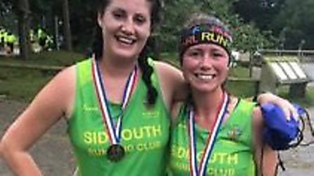 Sidmouth Running Club duo Laura Broughton (left) with Bex MacDonald after finishing the Forest Flyer