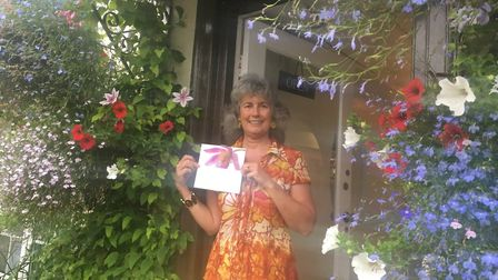 Pia-Maria Boast, of the Sidmouth Steps Dress Agency, with the note praising the shop's floral displa