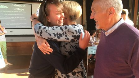 Anya Hawtin celebrates with her mum and dad after achieving seven Grade 9s, two Grade 8s and one Gra