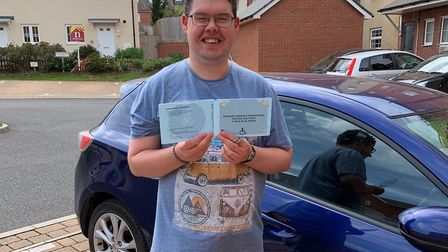 Ben Compton who has autism spectrum disorder with his blue badge. Picture: Robert Compton