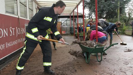 Sidmouth firefighters helped cleaning the playground at Tipton primary school. Ref sho 0511-01-16SH.