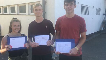 Liberty Shaw Reuben Smit and Luke Nicklin with their GCSE results. Picture: Clarissa Place