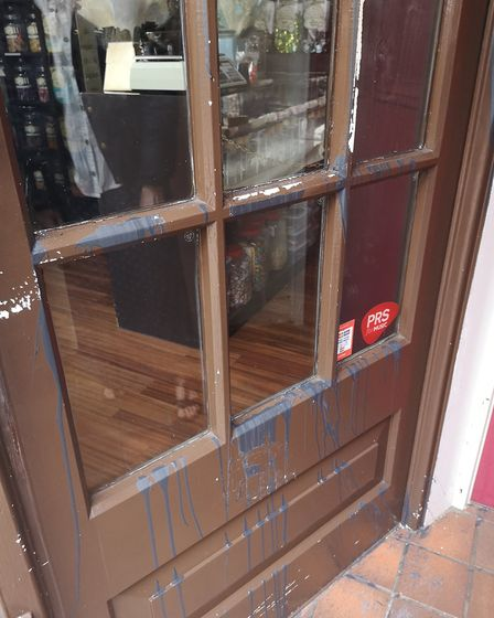 Paint was threw across the front door at Mr Simms Olde Sweet Shop in Church Street. Picture: Michell
