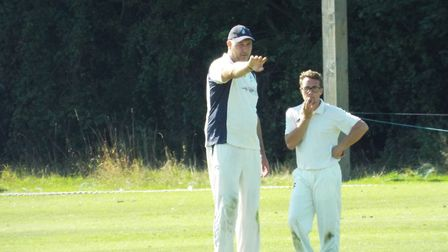 Rob Johns (left) and Jake Tierney discuss things during the Ottery St Mary 2nd XI win over Bradninch