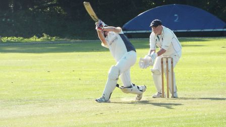 Dan Jeacock hits out dunig his half century innings for Ottery St Mary 2nds in the win over Bradninc