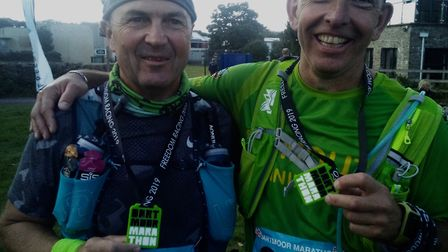 Sidmouth Running Club member Adrian Horne (left) with running buddy and friend Chris Carlton after T