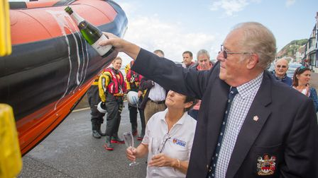 Derek Truesdale performs the ceremonial blessing with champagne at the Sidmouth Lifeboat Naming Cere