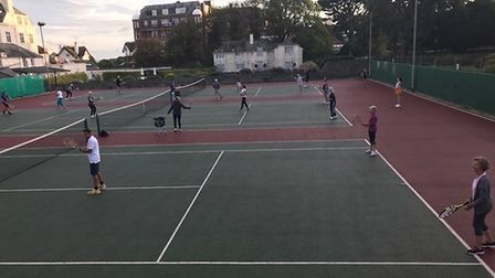 The triples competition taking place. Picture: Sidmouth Tennis Club