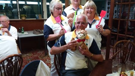 The Beech Hill touring side losing team with spades and teddy. Picture: SIDMOUTH BOWLS CLUB