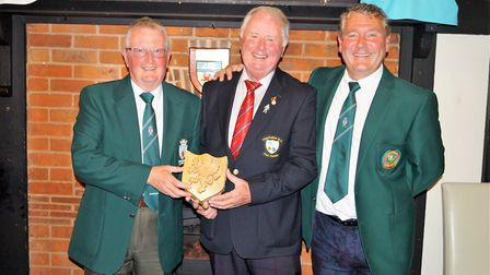 Brian Rice (left) receiving the Somerset Shield from Somerset captain Steve Butterfield (middle) wit