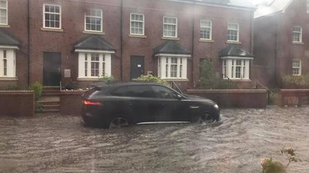 Cars have been seen trying to drive through the flood water. Picture: Imii Millard
