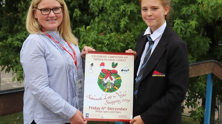 Sally Mynar, vice chair of Sidmouth Chamber of Commerce, presenting Matilda her prize of art supplie