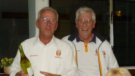 Sidmouth Bowls Club's Sunset Umbrella winner John Mason (left ) receiving his prize from Peter Mison