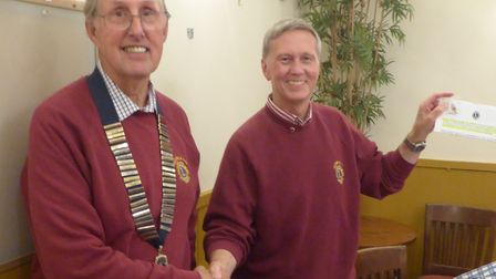 Lion President Chris presenting Lion Alan Shoesmith with Membership growth award. Picture: Sidmouth